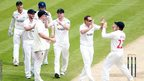 Glamorgan players celebrate taking the wicket of Kent's Mitchell Claydon as they wrap up victory in the County Championship before lunch on the final day in Cardiff.