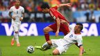 Cardiff City's Gary Medel of Chile tackles Spain's Diego Costa during the World Cup Group B match at the Maracana Stadium in Rio, Brazil.