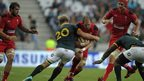 Wales captain Alun Wyn Jones is tackled by South Africa's replacement flanker Schalk Burger in what was a physical second Test.