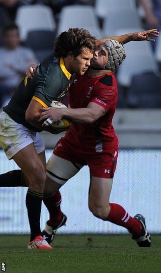 South Africa's Jan Serfontein is tackled by Jonathan Davies