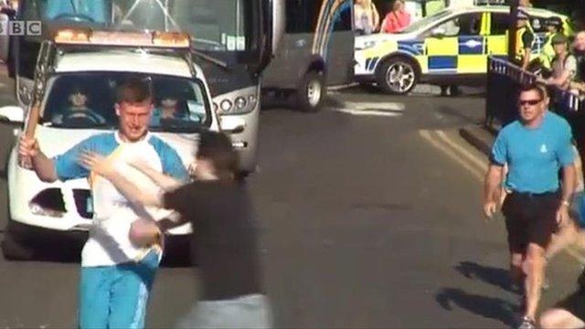 Man grabbing baton