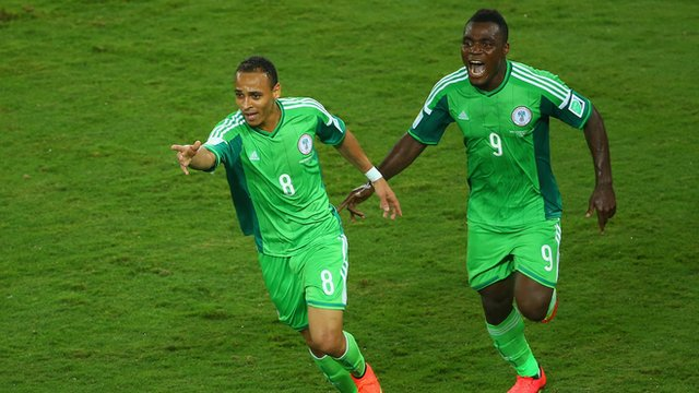 Nigeria's Peter Odemwingie (left) celebrates with Emmanuel Emenike
