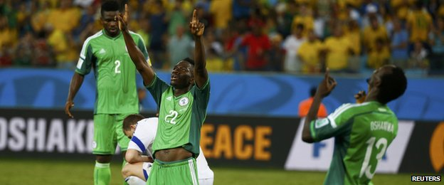Nigeria players Kenneth Omeruo (C) and Juwon Oshaniwa (R)