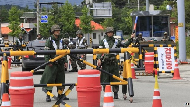 South Korean soldiers man a checkpoint near the Demilitarized Zone (DMZ) between the two Koreas in Gangwon province, South Korea, 22 June 2014