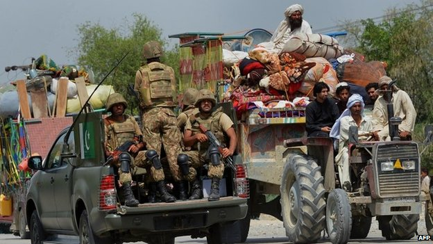 Pakistani troops patrol as civilians, flee North Waziristan. Photo: 20 June 2014