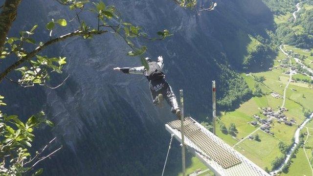 the girls base jumping off cliffs in the swiss alps bbc news