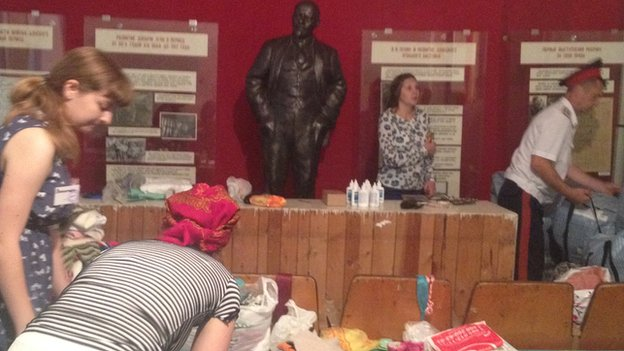 Lenin looks on at the museum of coal as volunteers and Cossacks pack humanitarian aid for Ukrainian refugees