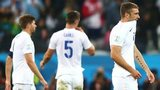 England players look dejected after they lose 2-1 against Uruguay at the 2014 World Cup