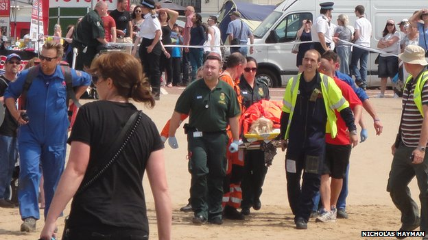 Casualty being stretchered to the air ambulance