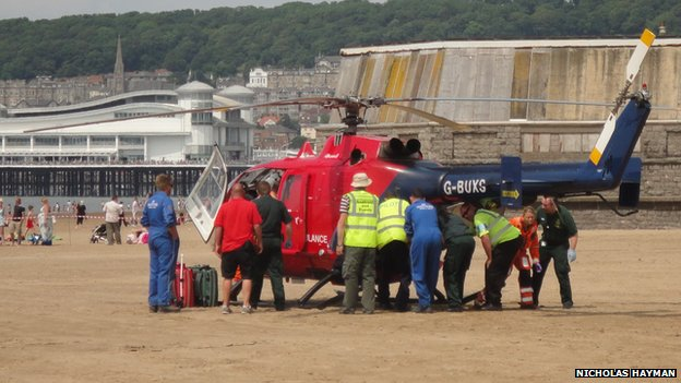 Casualty being loaded into the air ambulance