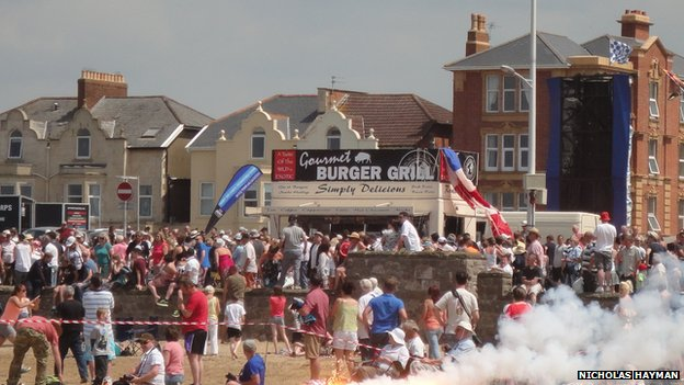 Burger stand with parachute draped over side