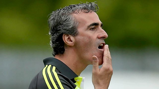 Donegal manager Jim McGuinness watches his team's game against Antrim
