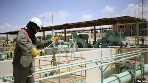 A worker maintains oil pipelines at the Zueitina oil terminal in Zueitina, west of Benghazi April 7, 2014