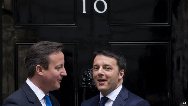 File photo: British Prime Minister David Cameron, left, greets Italy's Prime Minister Matteo Renzi before their meeting at 10 Downing Street in London, 1 April 2014