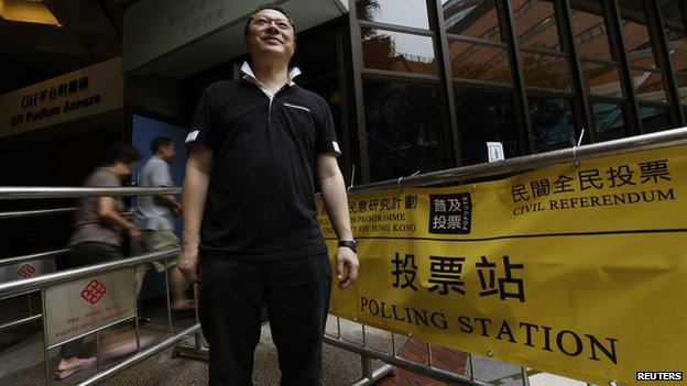 Associate Law Professor Benny Tai poses outside a polling station in Hong Kong on 22 June, 2014
