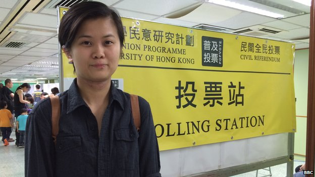 Financial analyst Natalie Cheng poses outside a polling station in Hong Kong