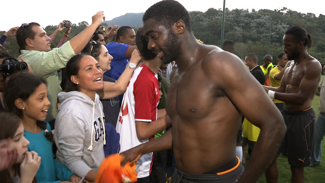 Ivory Coast's Kolo Toure gives his training shirt to a delighted fan