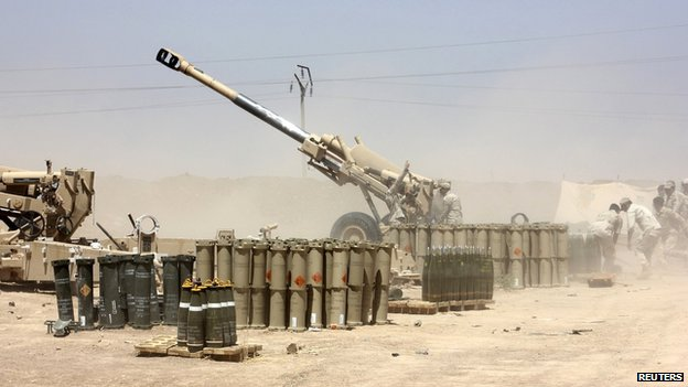 Iraqi security forces fire artillery during clashes with Isis militants on the outskirts of the town of Udaim in Diyala province on 22 June 2014