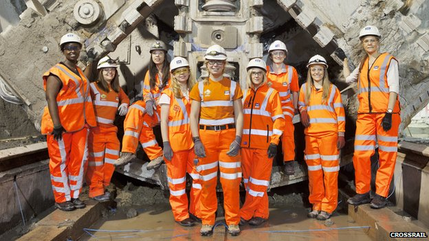 Female Crossrail engineers in front of one of the drills