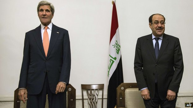 US Secretary of State John Kerry and Iraqi PM Nouri al-Maliki meet in Baghdad on 23 June 2014