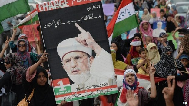 Pakistani supporters of preacher Tahir-ul-Qadri protest against the killing of followers during clashes with police, in Islamabad on June 19, 2014.