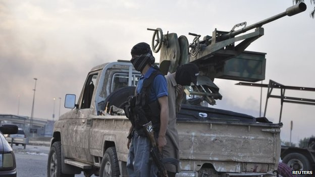 ISIS fighter at a checkpoint in Mosul (11 June 2014)