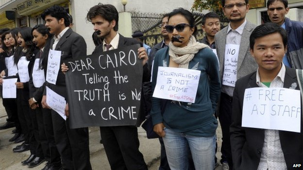 Nepalese journalists and law students demanding the release of journalists for al-Jazeera held in Egypt demonstrate outside the Egyptian embassy in Kathmandu, 24 March 2014