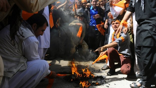 Supporters of Abdullah Abdullah burnt their voter registration cards in Herat in protest against the alleged fraud. Photo: 22 June 2014