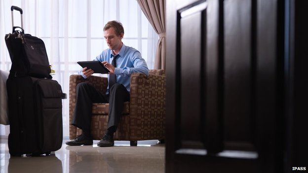 Businessman in hotel on tablet