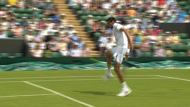 Hanescu hits the ball through his own legs