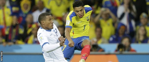 Luis Garrido of Honduras fights for the ball with Ecuador's Jefferson Montero (right)