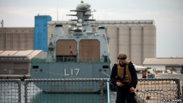 A sailor patrols the deck of a Norwegian Navy vessel used to transport chemical weapons out of Syria - 2 January 2014