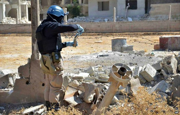 A UN investigator takes samples from the site of a suspected chemical weapons attack in Damascus - 28 August 2013
