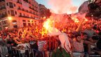 Algerian football fans burn flares as they celebrate their team's World Cup victory over South Korea in Algiers on 22 June 2014.