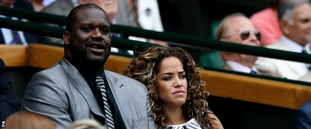 Shaquille O'Neal sits with Laticia Rolle