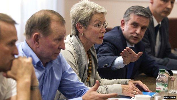 Former Ukrainian President Leonid Kuchma, OSCE Ambassador Heidi Tagliavini and Russian Ambassador to Ukraine Mikhail Zurabov meet Donetsk and Luhansk separatist leaders on 23 June