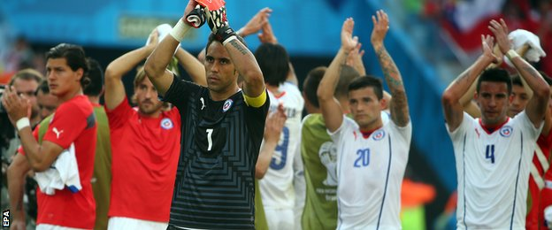 Chile's players applaud their fans after their first defeat of the tournament