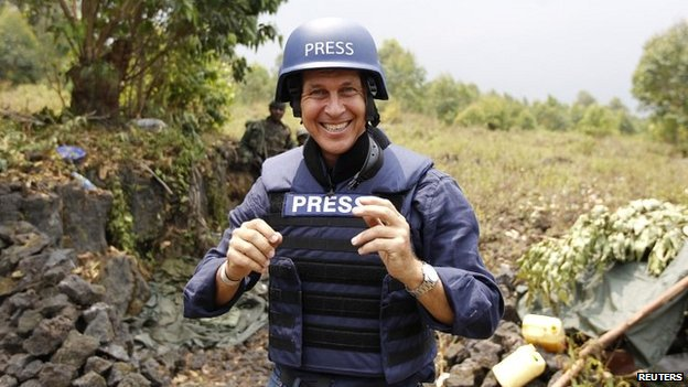 Peter Greste poses for a photograph while reporting for al-Jazeera in the Democratic Republic of Congo - 7 August 2013