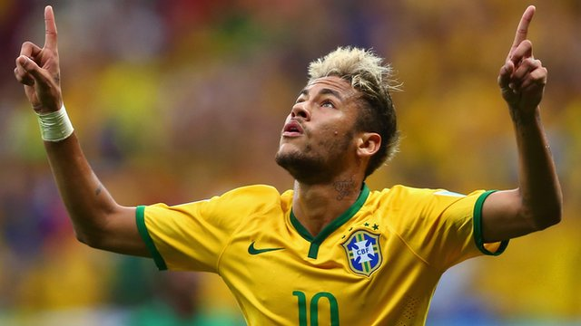 Brazil's Neymar celebrates goal against Cameroon
