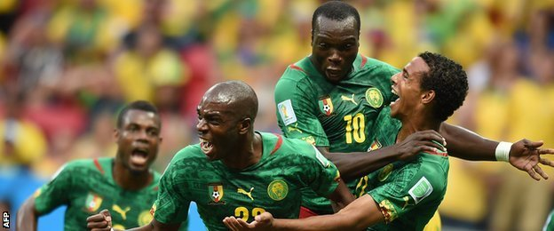 Joel Matip of Cameroon celebrates with his Cameroon team-mates