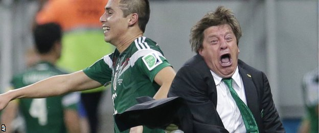 Mexico manager Miguel Herrera shows his delight after his side score against Croatia