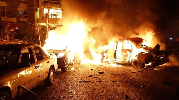 Fire engulfs cars at the site of blast in the Lebanese capital Beirut - 24 June 2014
