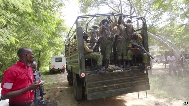 A truck loaded with Kenyan security officers patrols in Mpeketoni town on 18 June 2014