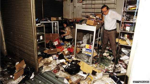 A Chinese store owner surveys the damage after a looting in Jakarta, Indonesia on 16 May 1998
