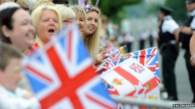 Members of the public carrying Union flags waited outside the jail for the Queen to arrive