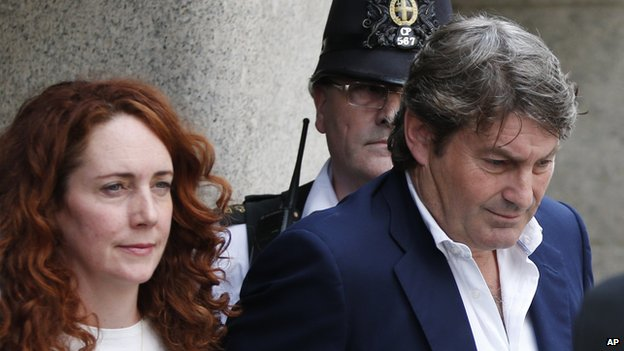 Rebekah and Charlie Brooks leave court on 24 June 2014