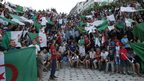 Algeria fans in Algiers watch their national team's World Cup Group H game against South Korea