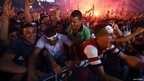 Algeria fans in Algiers celebrate their national team's 4-2 win over South Korea