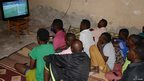 Fans in Mogadishu watch a live screening of the opening game between Brazil and Croatia