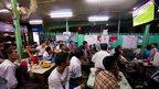 Burmese fans watch Spain's victory over Australia in Rangoon
